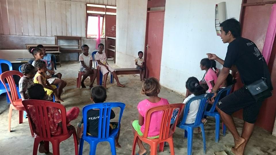 teaching Papuan children in West Papua